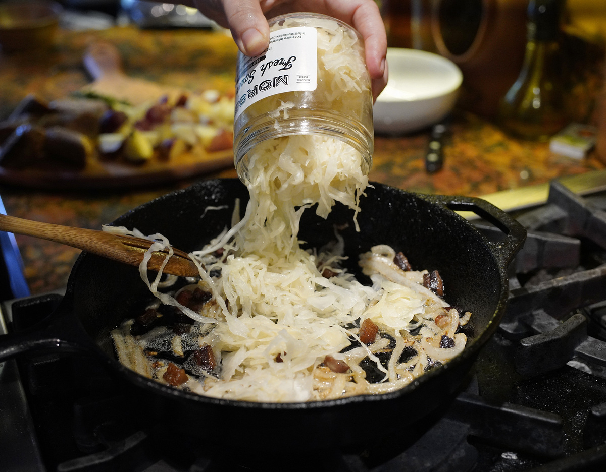 Cook adds Morses sauerkraut to a pan.
