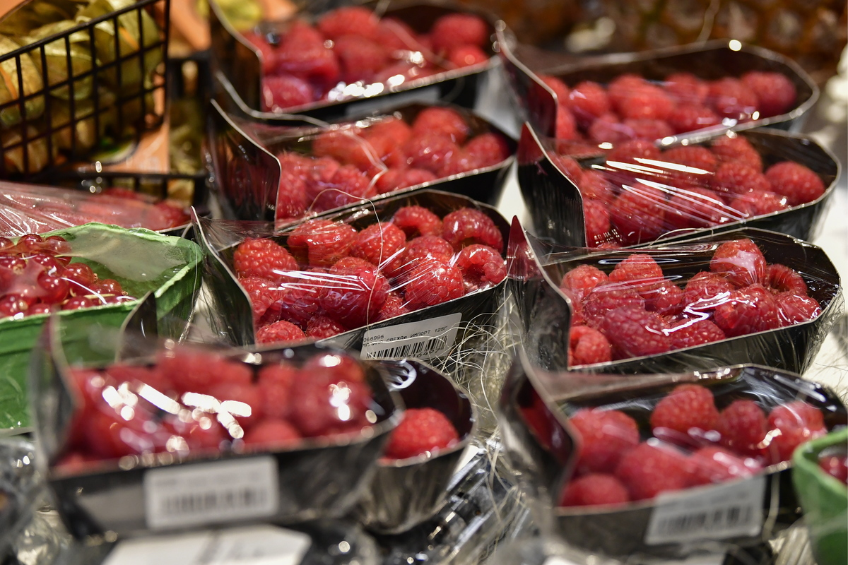 Raspberries wrapped in plastic are on display in a new hypermarket.