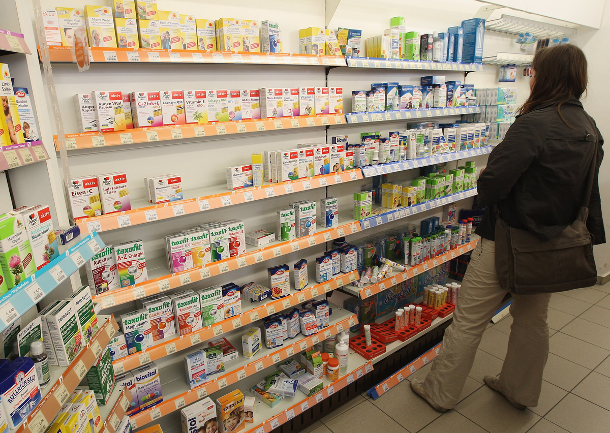 A shopper looks among health supplements at a drugstore.