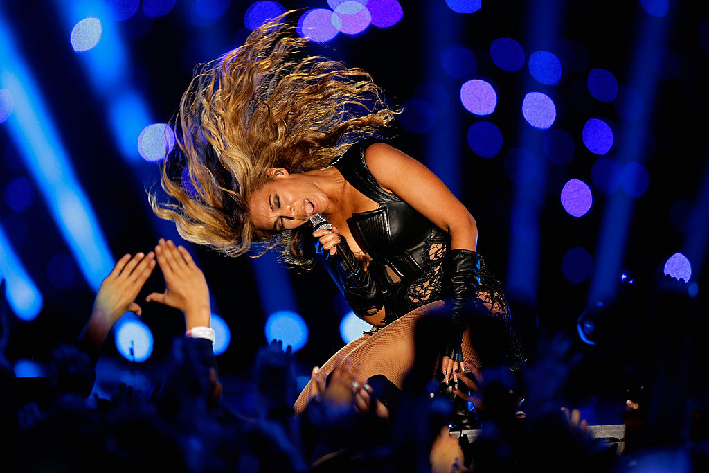 Beyonce slips her hair while singing onstage.