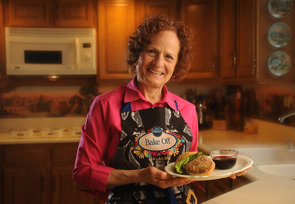 woman holding turkey burgers