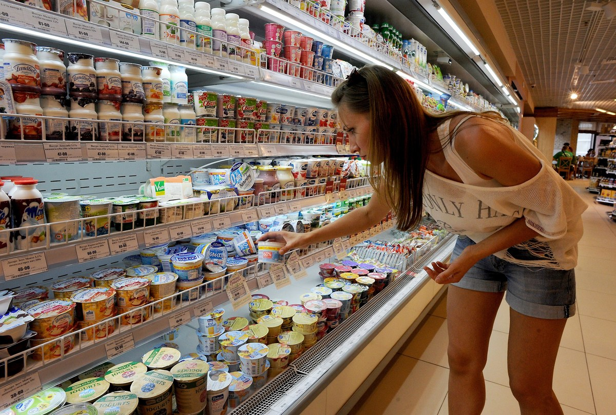 A woman shops for yogurt in a Saint Petersburg grocery store.