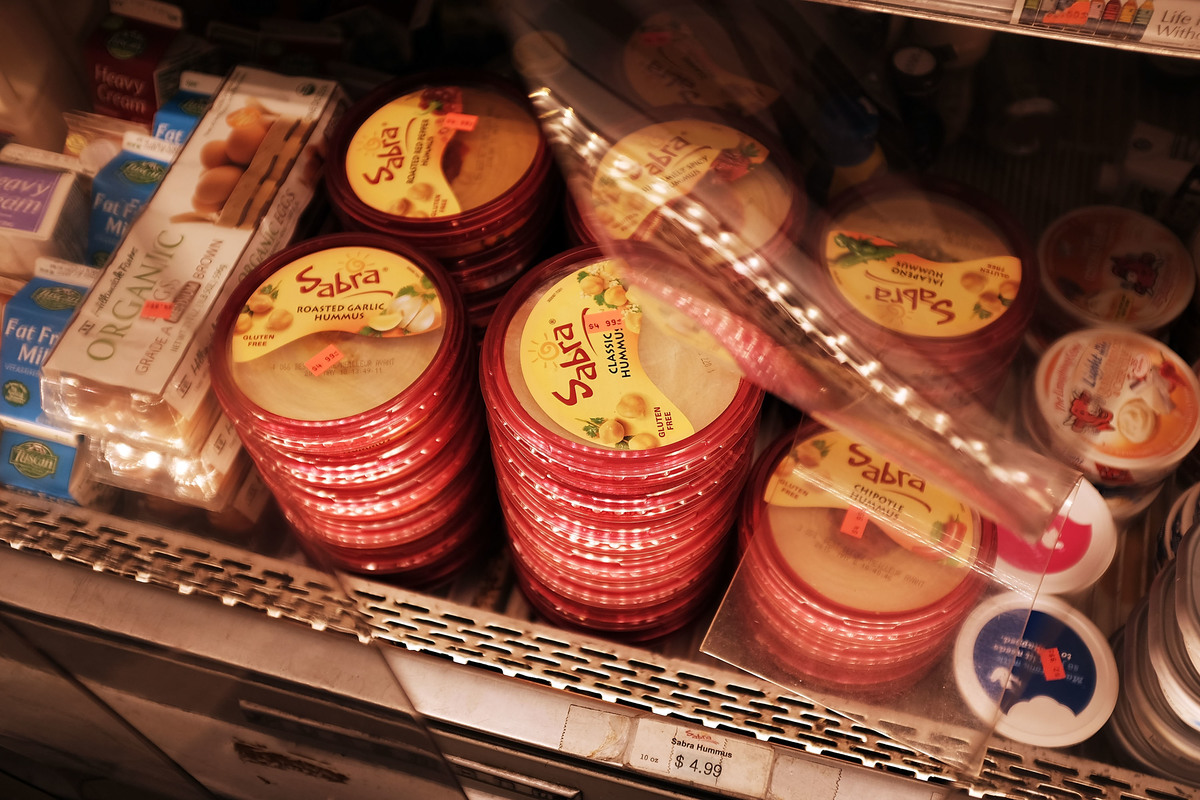 Cases of Sabra Classic Hummus are viewed on the shelf of a grocery store.
