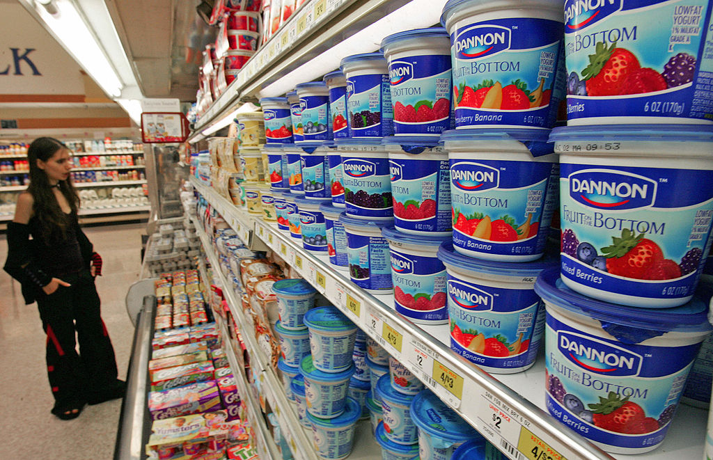 A woman shops for yogurt.