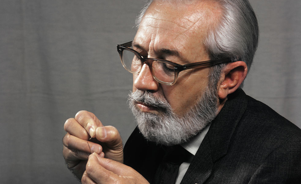 Man trying to thread a needle