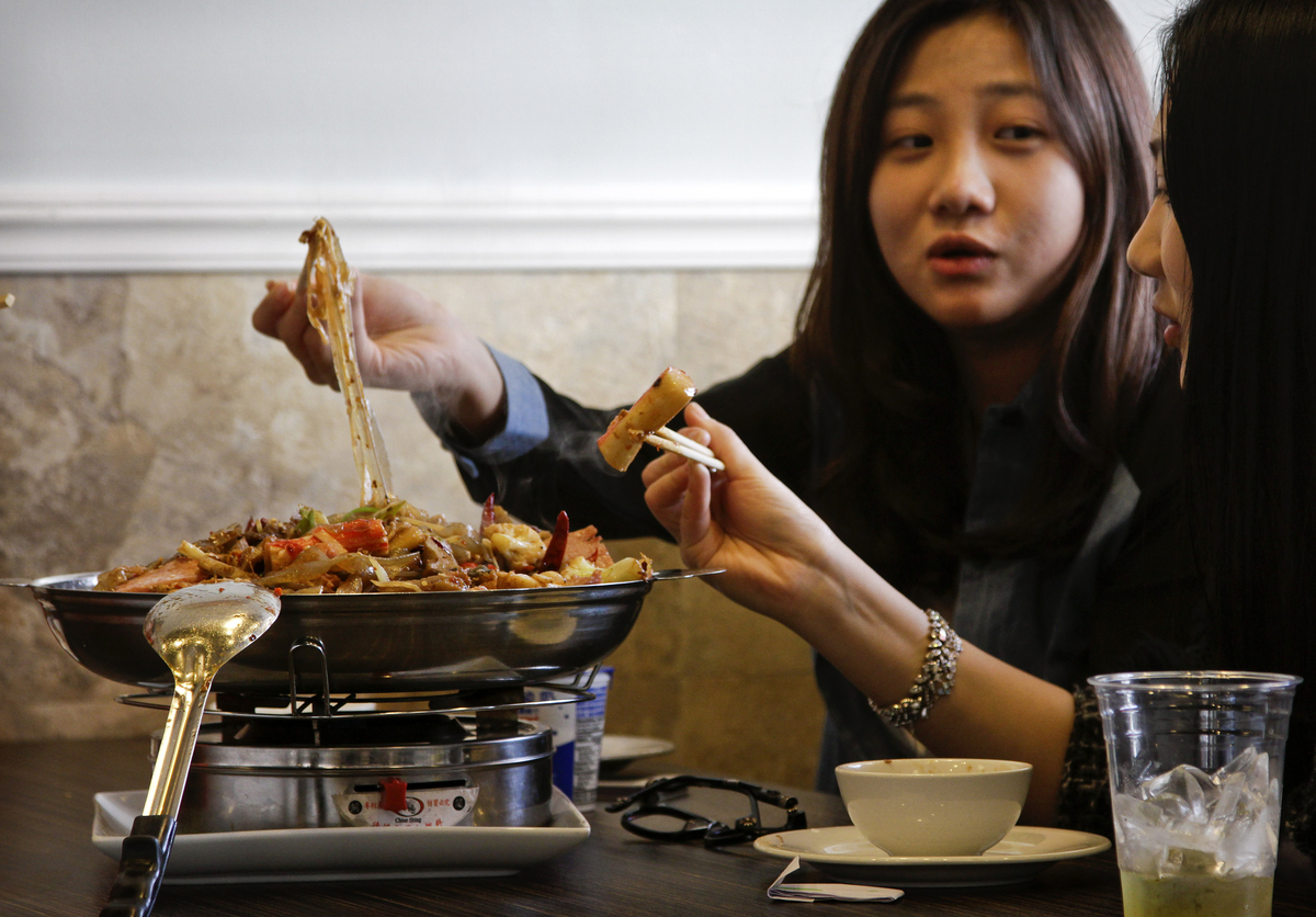 Customers eat lunch at Tasty Dining, a Chinese style restaurant.