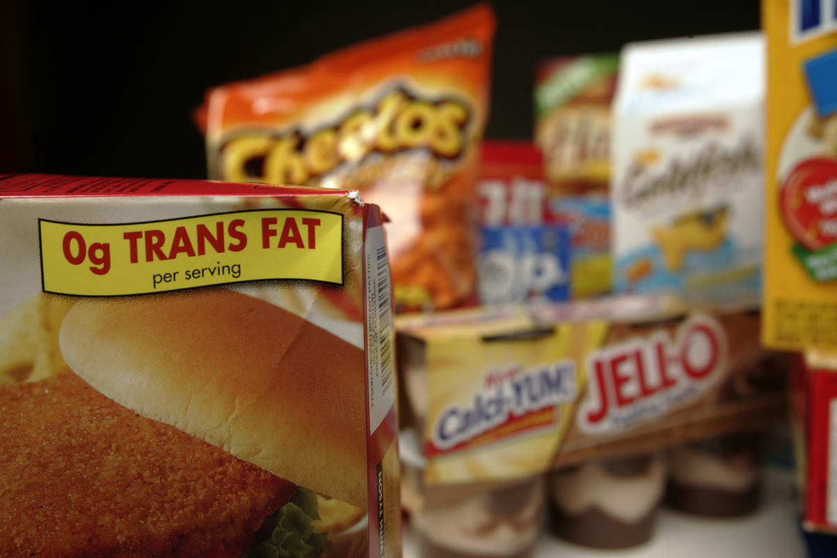 Food packages labeled with trans fats are shown.