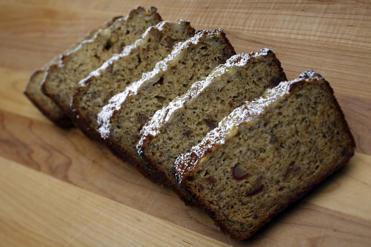 Banana bread from Huckleberry is laid out on a cutting board.