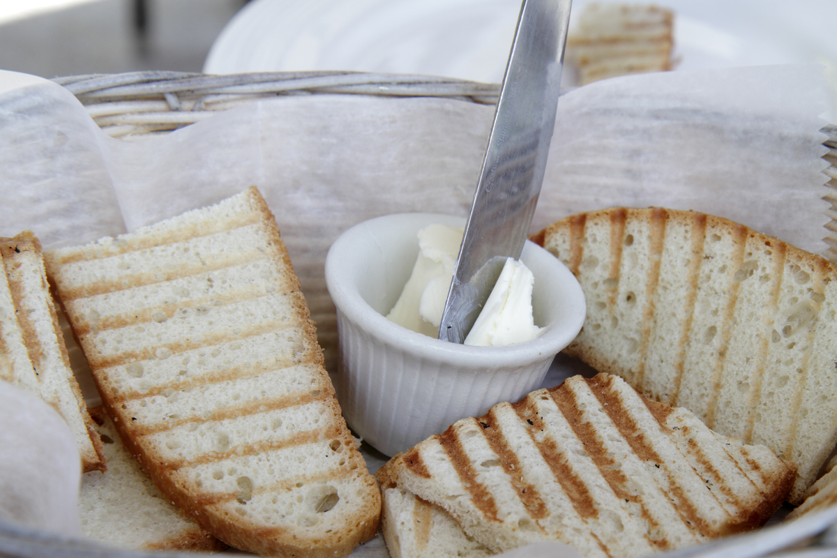 Close-up shot displays butter with toast.