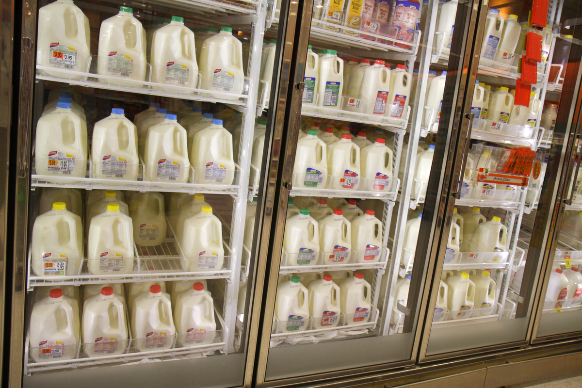 Dairy products are on shelves inside of a refrigerator in Shaw's grocery store.