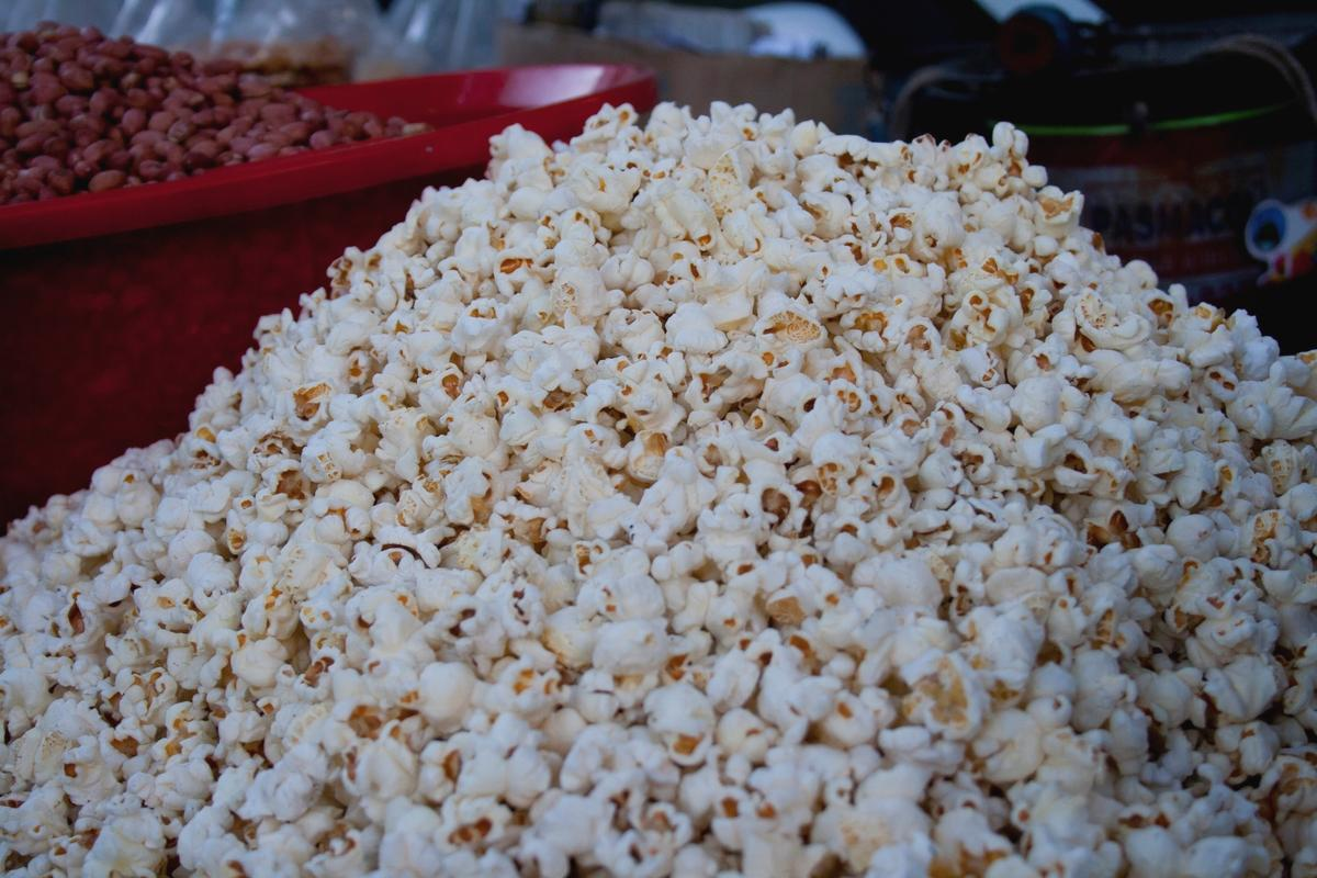 Popcorn is sold in a big pile.