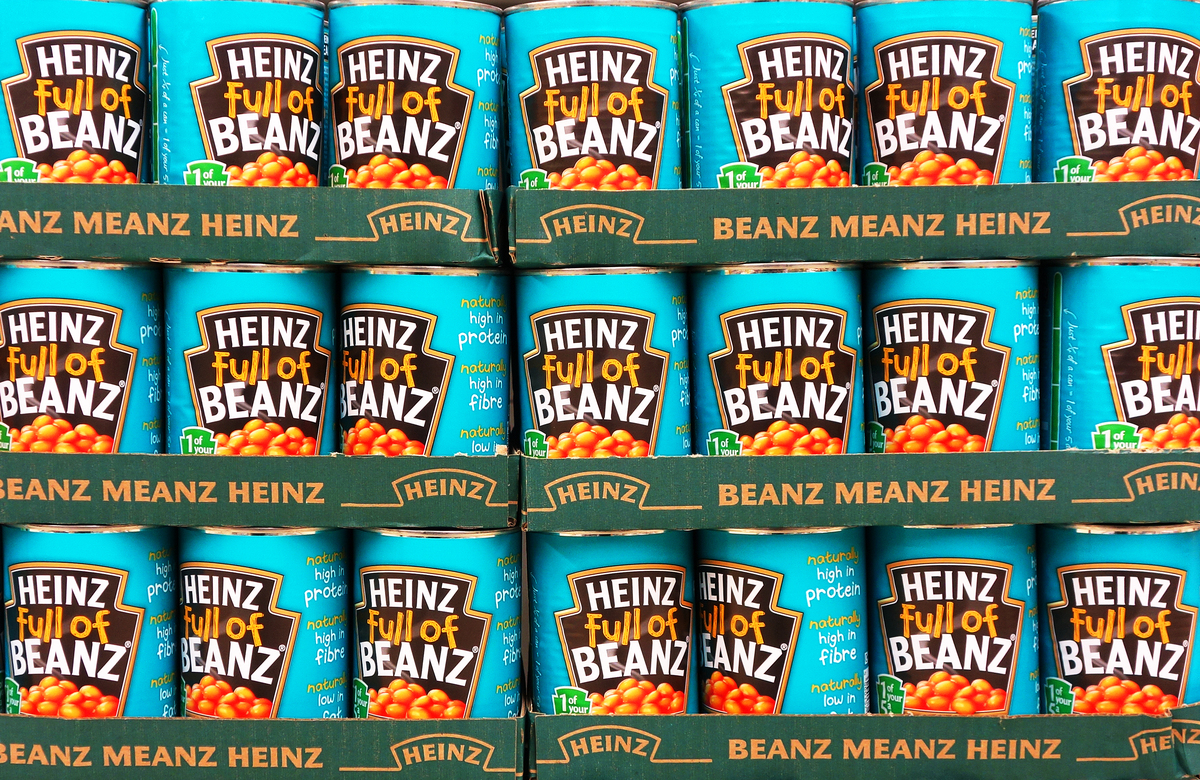 A store displays shelves of Heinz beans.