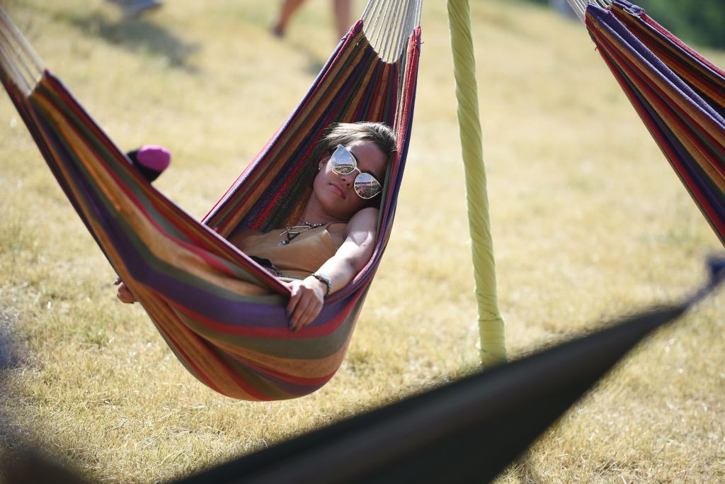 A woman relaxes in a hamoc.