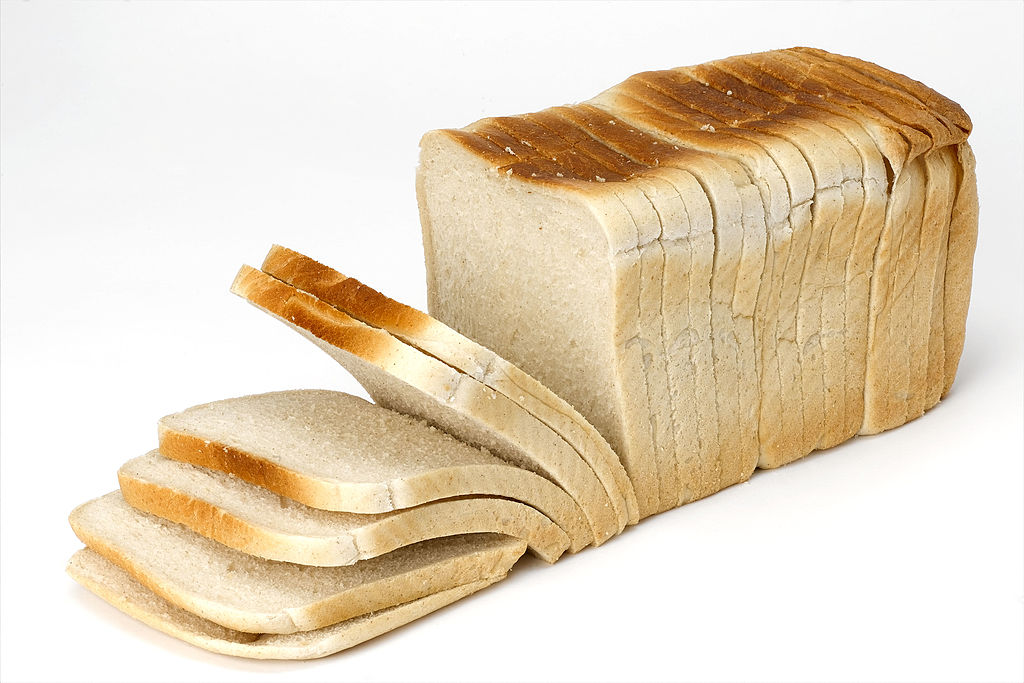 Slices of a loaf of bread toppel over.