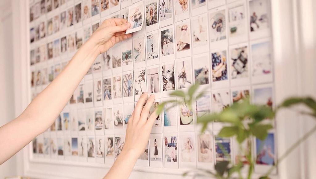 Woman haning polaroids