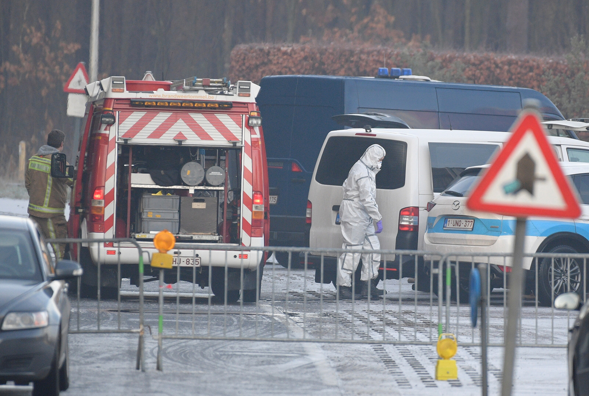 This picture shows police forensics at work near the site of a hangar.