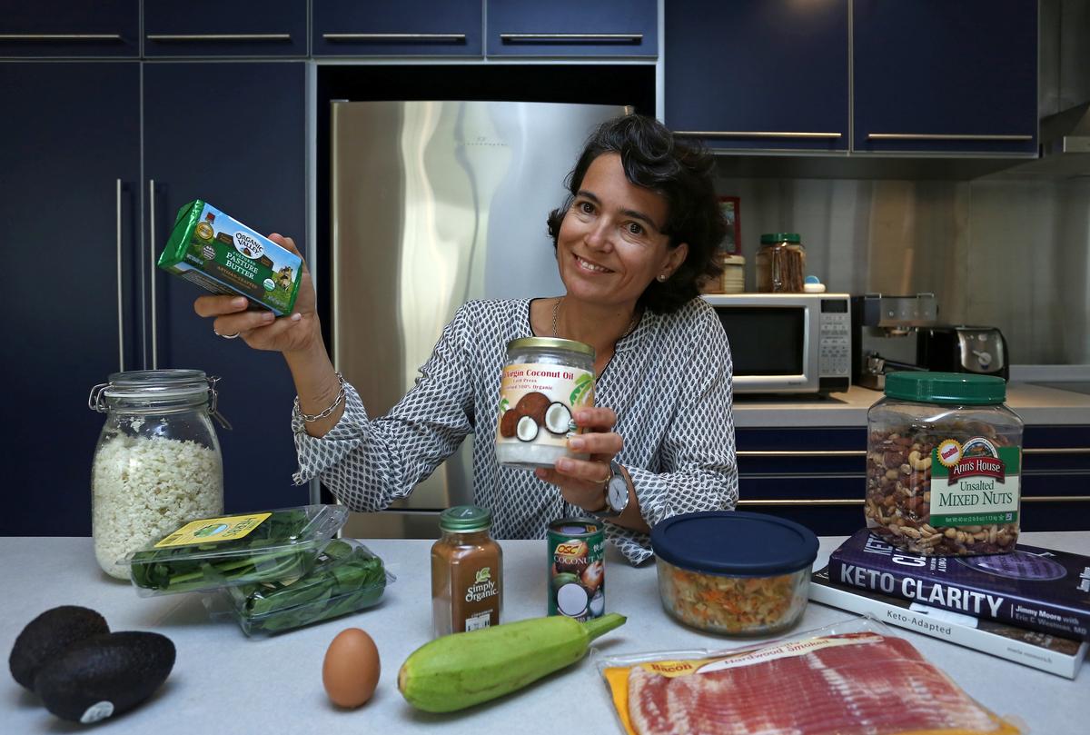 Stefanie Hemshall holds food produce for her ketogenic diet.