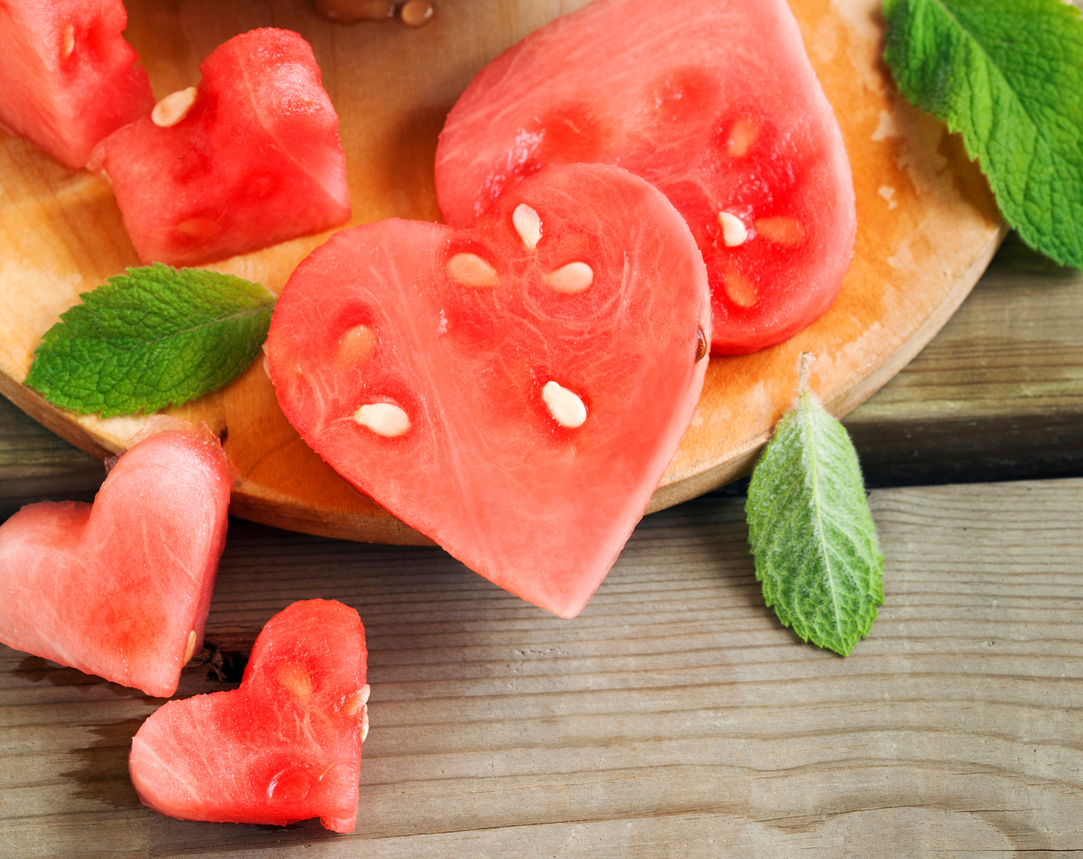 Watermelon is cut into heart-shaped slices.