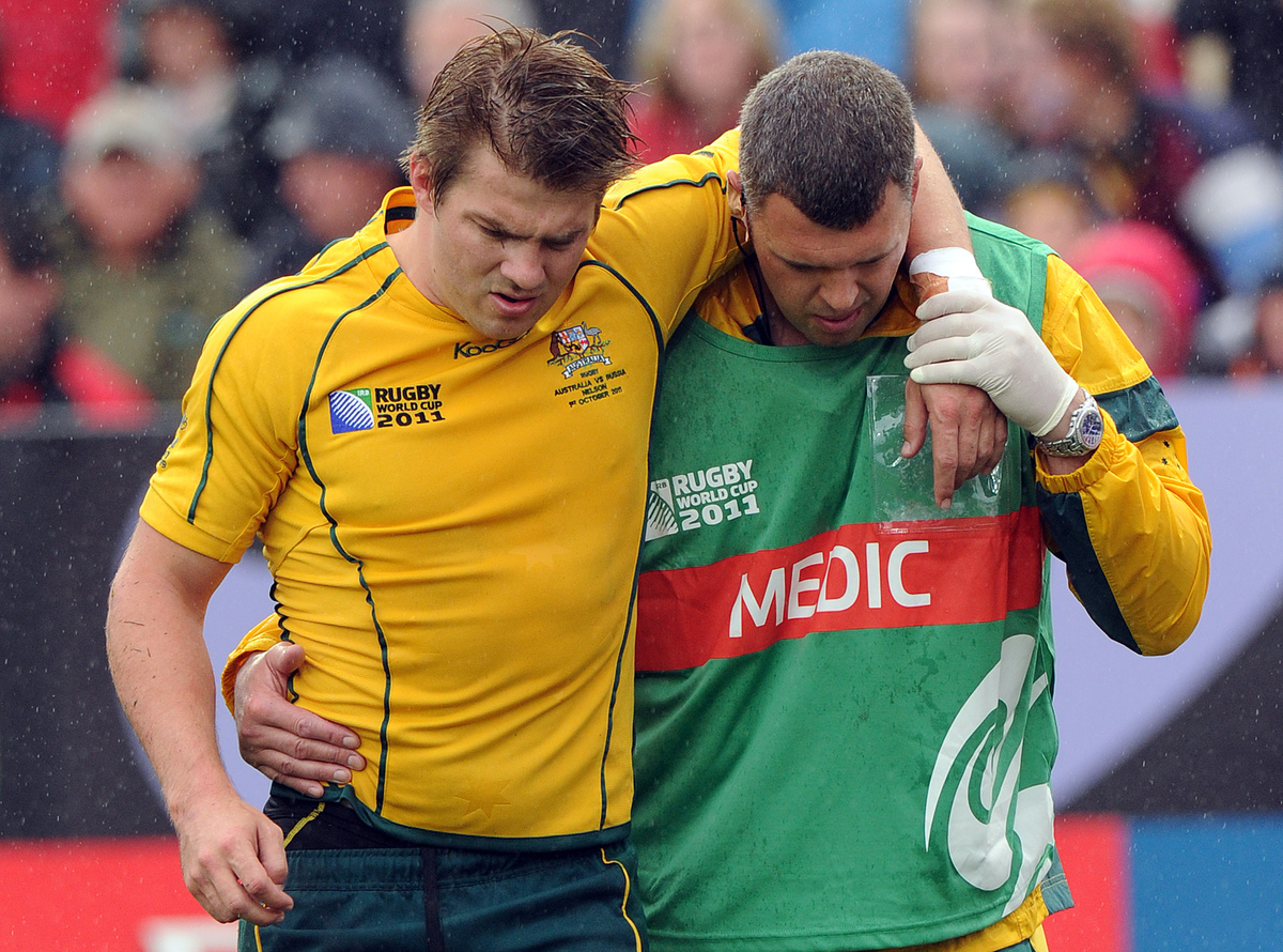 Australia's Wallabies wing Drew Mitchell is assisted off the field with a suspected hamstring injury.