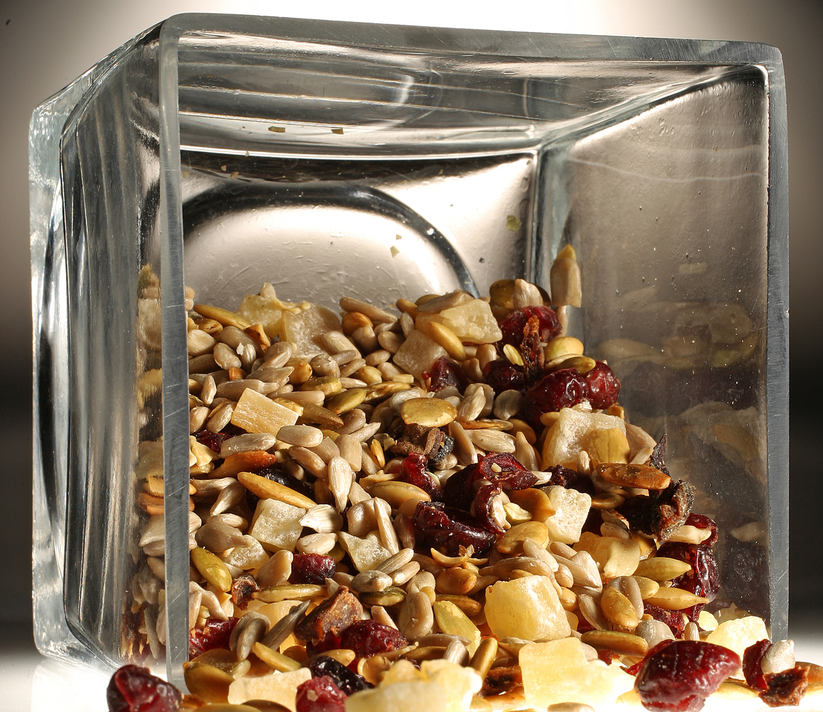 Trail mix are in a glass bowl.