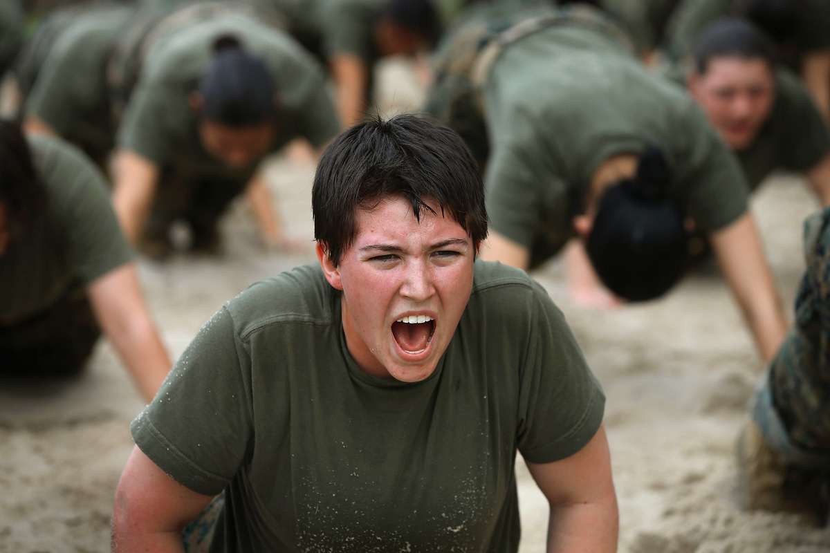 Female Marine recruits are disciplined with some unscheduled physical training during boot camp.