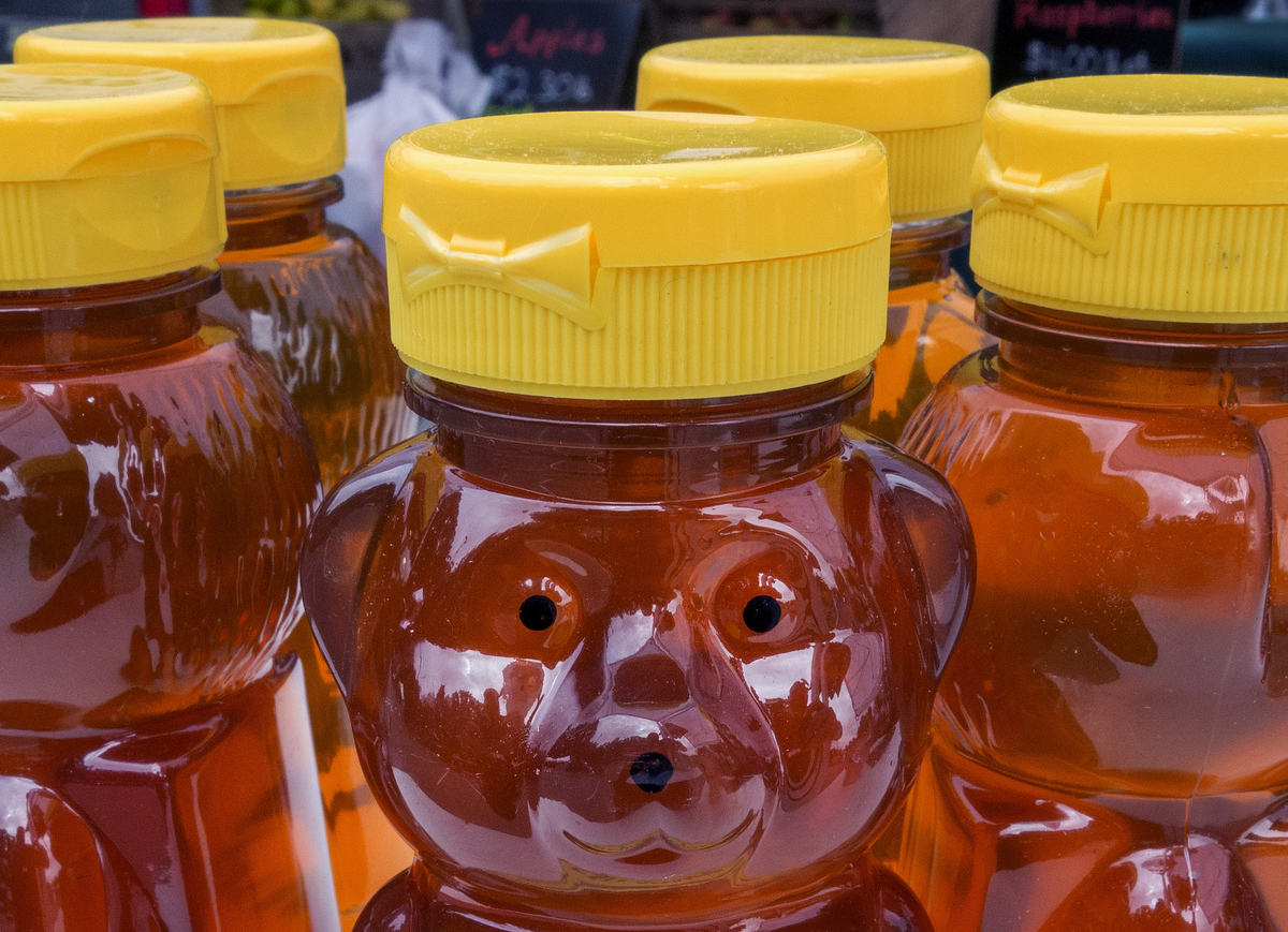 Fresh honey is stored in bear-shaped jars at a local