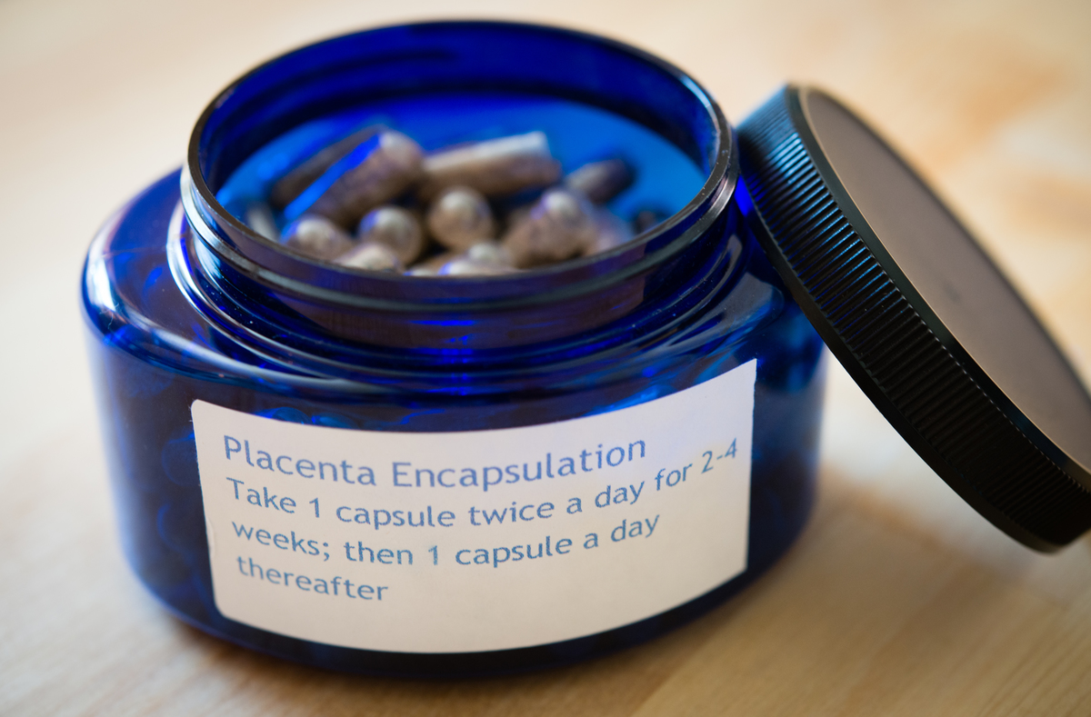 Placenta pills are contained in a blue bottle.