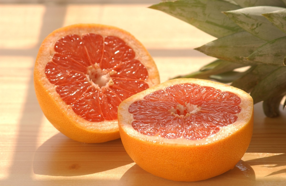 A grapefruit is sliced in half.