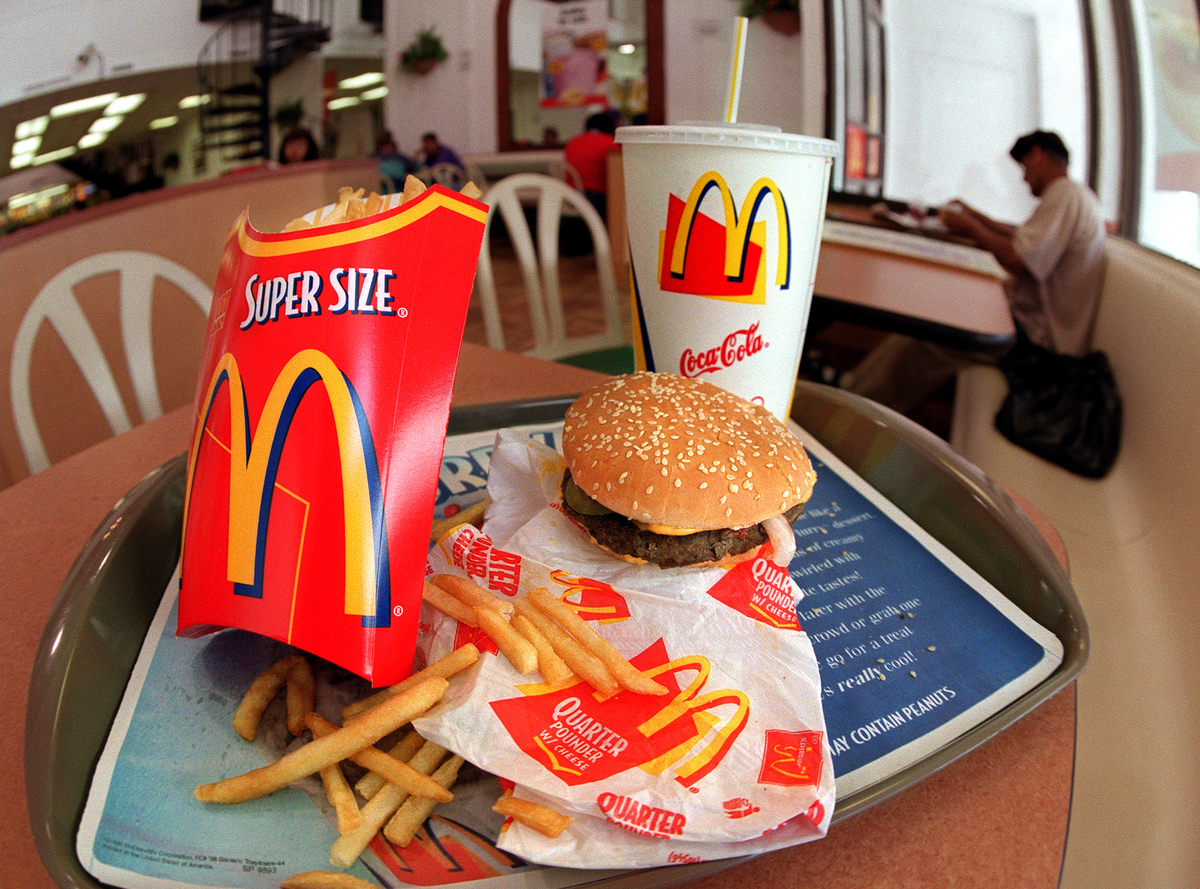 A super-sized meal sits on a table at McDonald's.