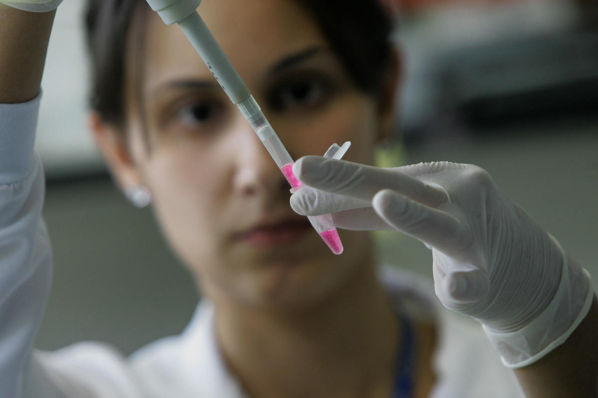 A scientific researcher extracts the RNA from embryonic stem cells in a laboratory.