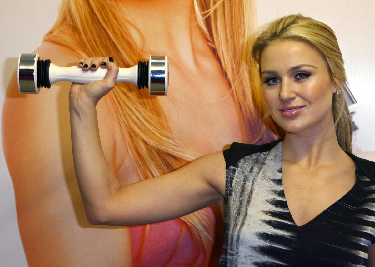 Alex Gerrard demonstrates Shake Weight, a women's fitness product that shapes and tones arms in just six minutes a day.