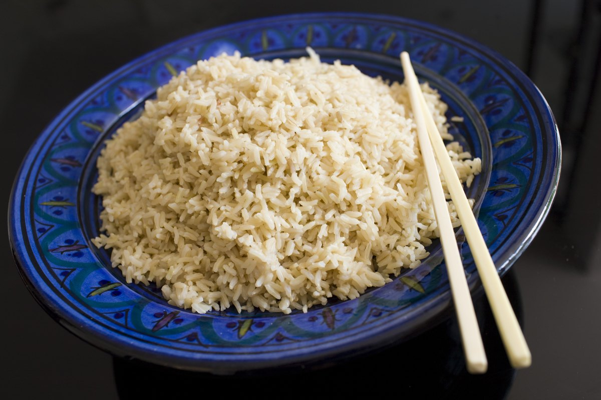 Bowl contains brown wholegrain rice and chopsticks