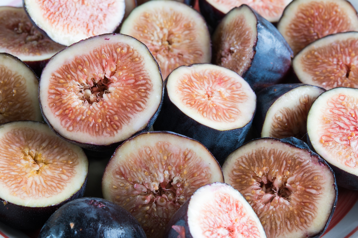 A close up shows sliced fig fruits.
