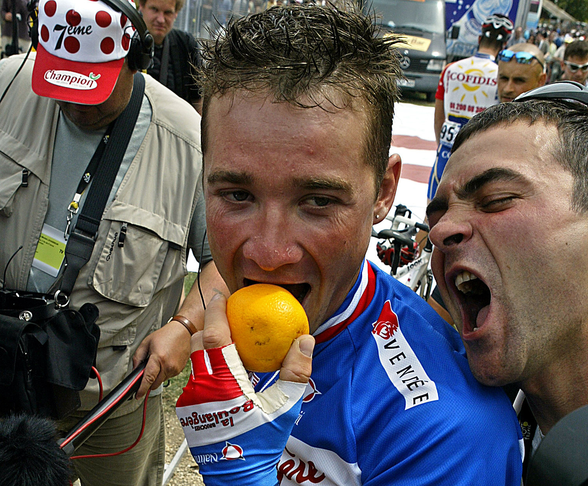 French Thomas Voeckler celebrates after receiving the Orange Prize awarded to the nicest rider of the pack.