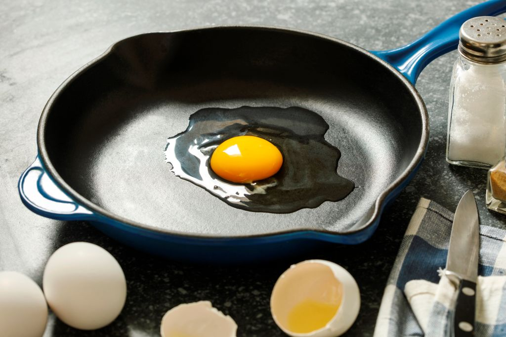 a raw egg in a frying pan