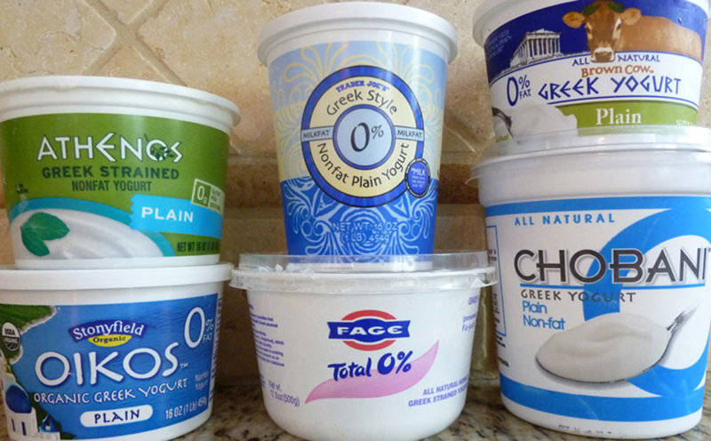 low fat and nonfat yogurts of different brands are stacked.