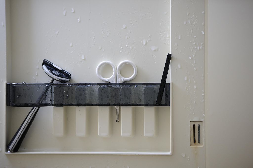A straight razor and a small chisel are seen in the bathroom