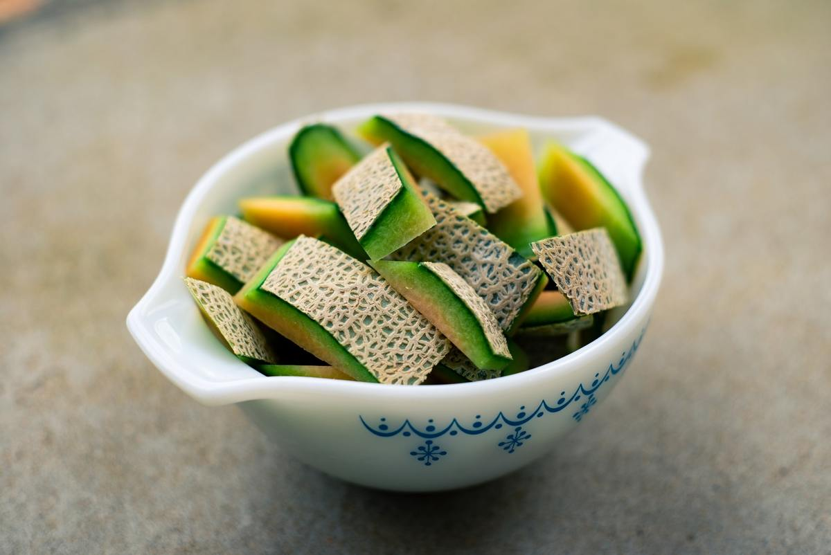 Sliced cantaloupe sits in a bowl.
