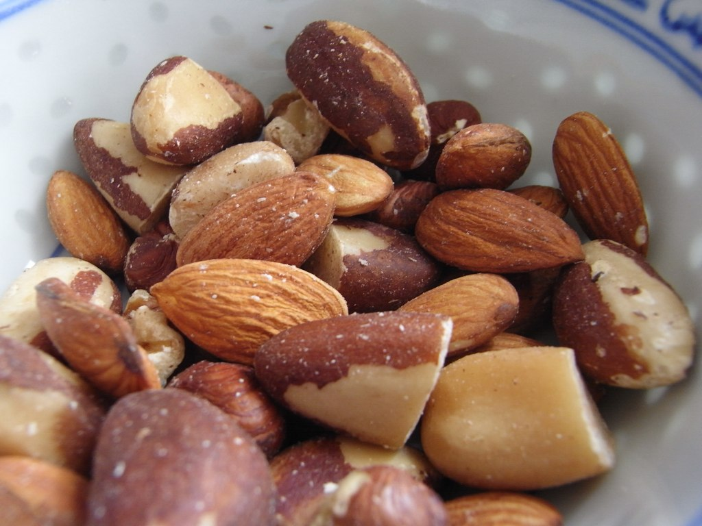 A close-up shows almonds in a bowl.