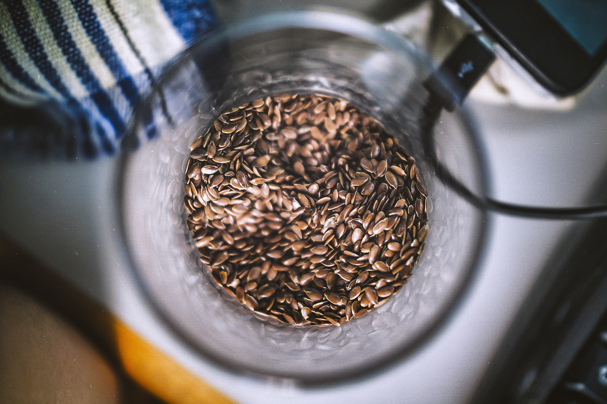 Flaxseeds sit in a blender.