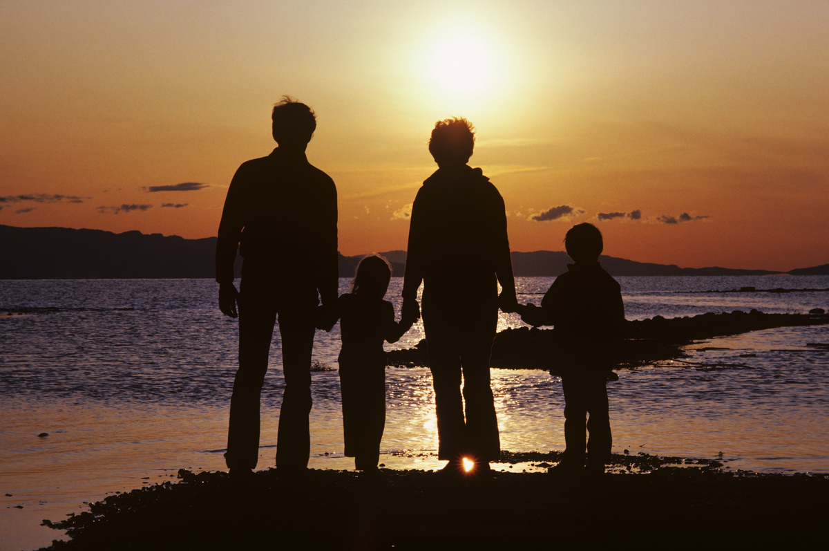 A family watches the sunset together.