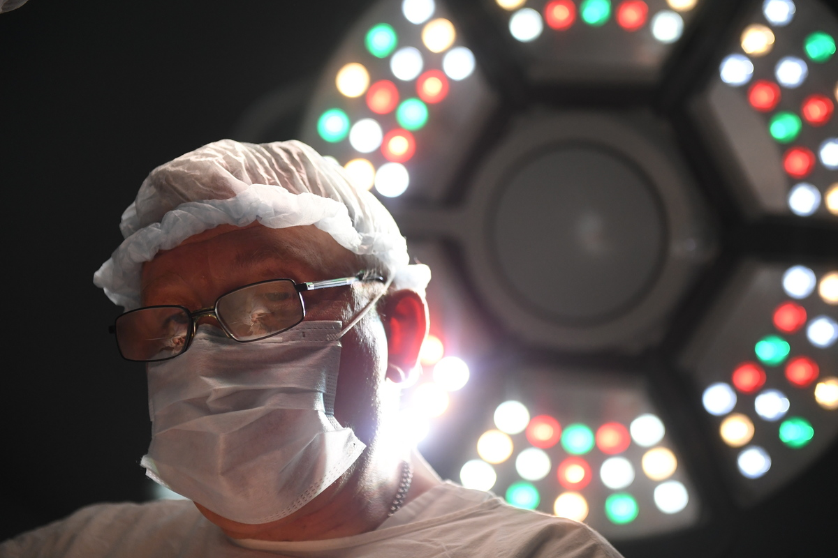 A doctor conducts surgery at a children's hospital.