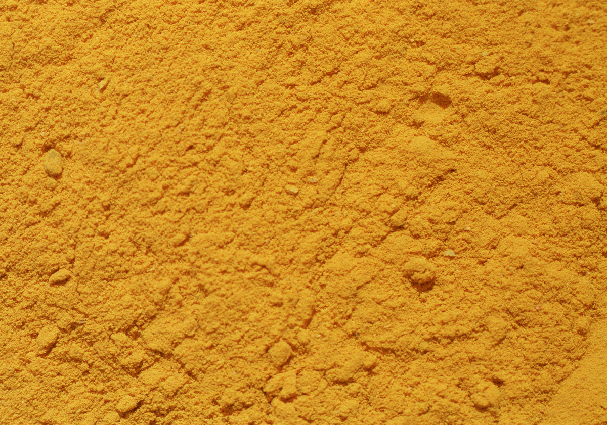 Crushed orange turmeric powder is seen.