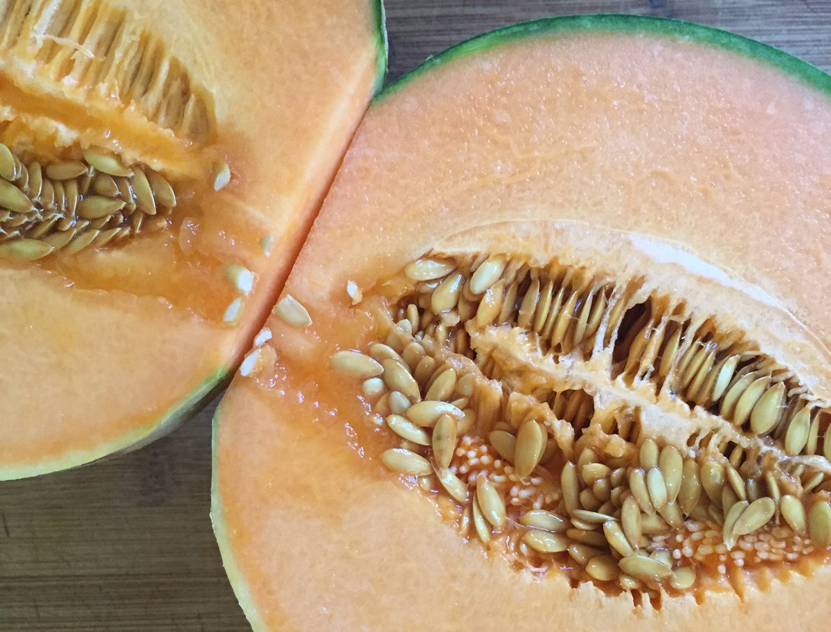Cantaloupe seeds are seen before being dug out and ground into a smoothie.