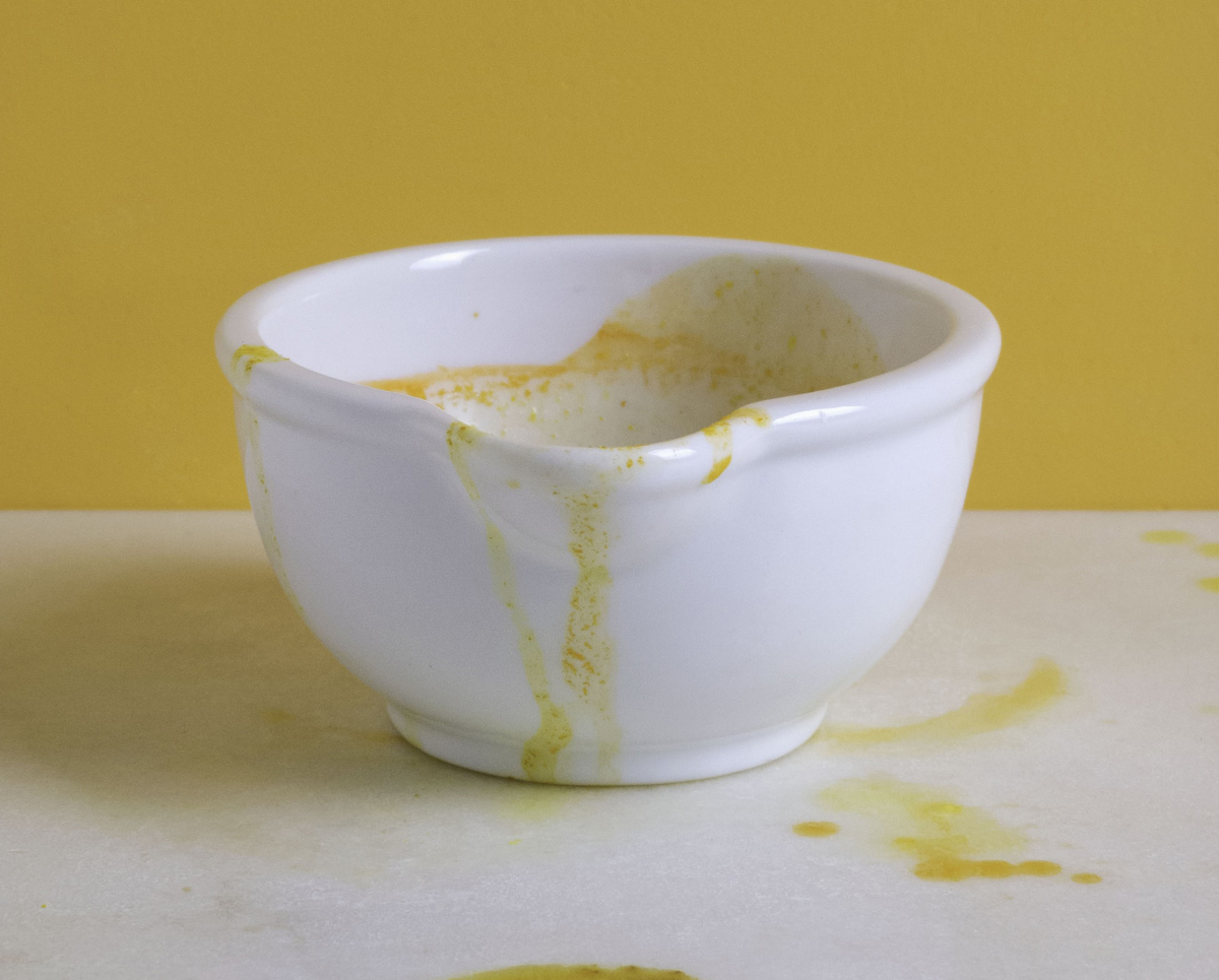 Turmeric stains a white cup.