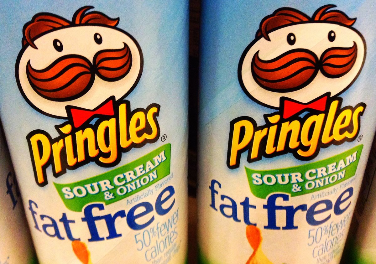 Two cans of fat free Pringles are seen.