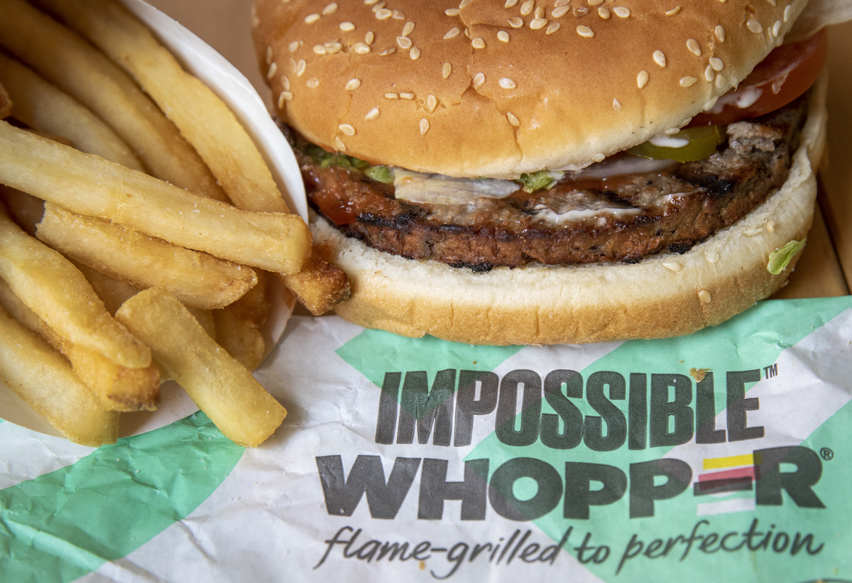 Burger King's Impossible Whopper, a vegetarian soy-based burger, sits on its wrapping.