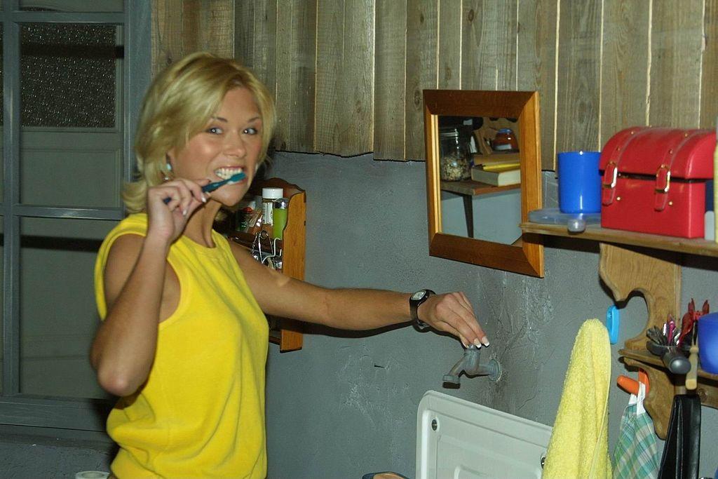 brushing her teeth