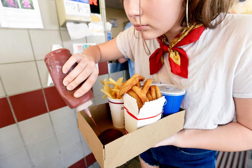 woman-squirting-ketchup
