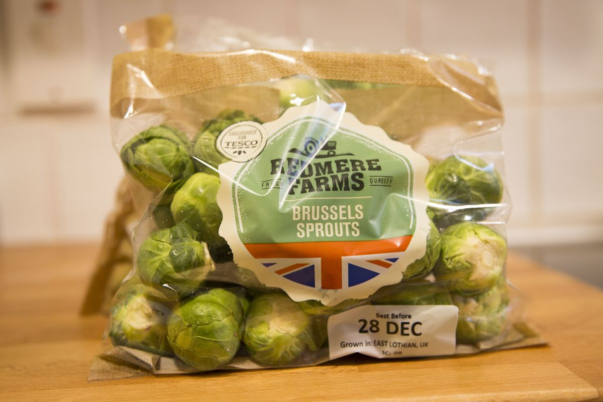 Brussels sprouts are wrapped in a plastic bag from a supermarket.
